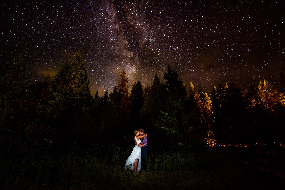 Wedding couple stands under the milky way the Vallican Whole Community Centre