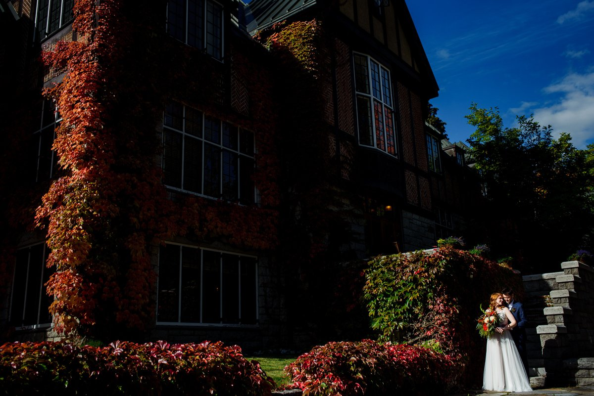 Fall wedding portrait in front of blaylock mansion in nelson bc