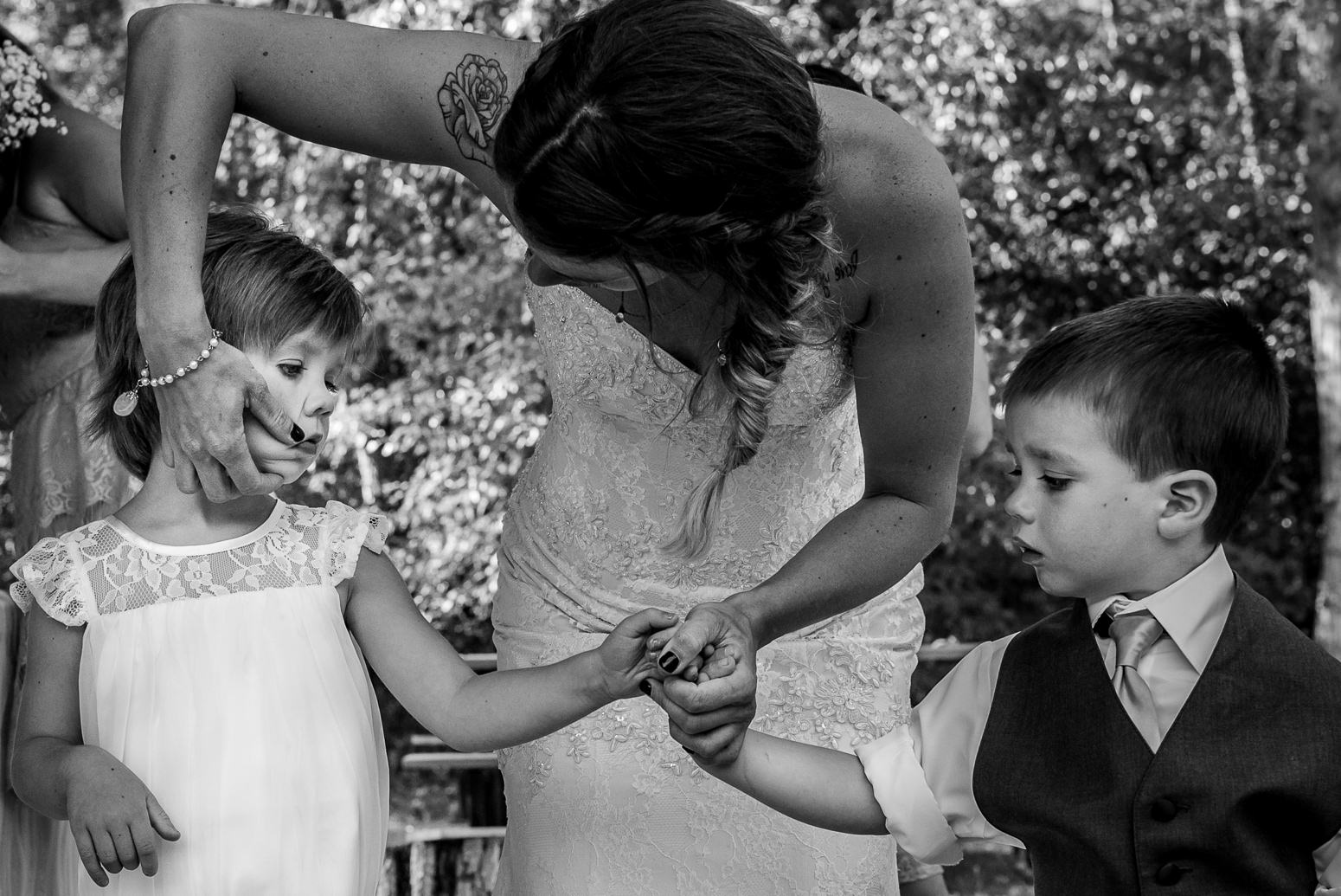 Mom cleans her kid's face before her Birchbank campgrounds wedding near trail bc