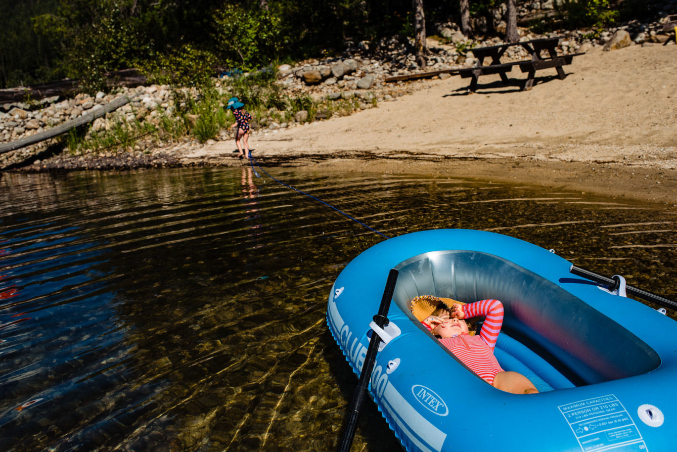 girl pulls her cousin in boat on kootenay lake
