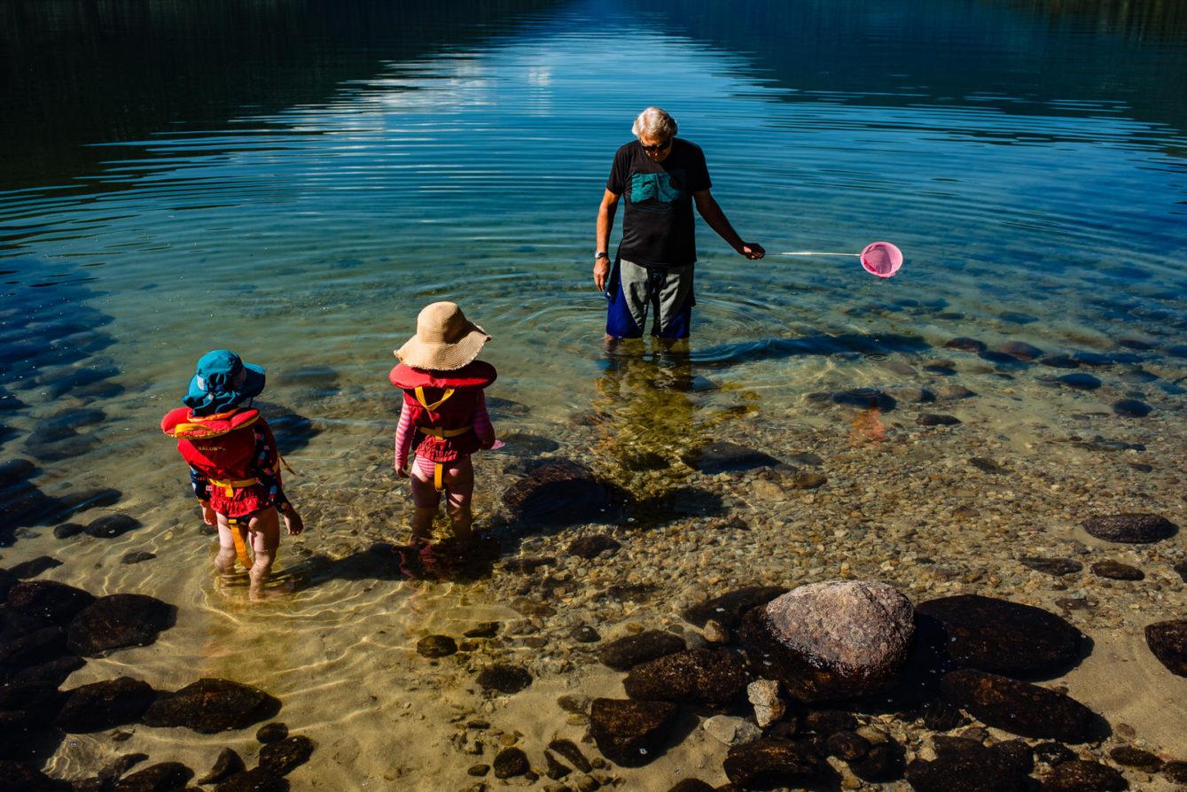 grandpa looks for minnows in kootenay lake