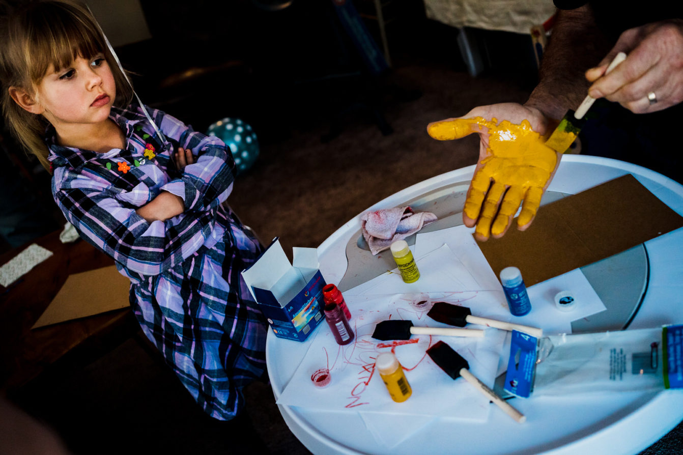 girl doesn't want to paint her hand during finger painting