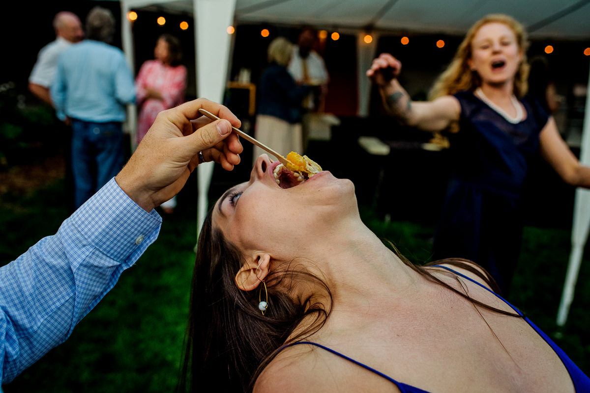 Guest eats peach pie while dancing at Burton City Cidery wedding
