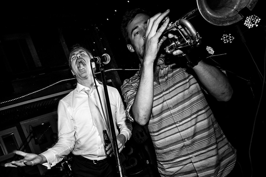 Groom sings behind trumpet player at nelson bc wedding