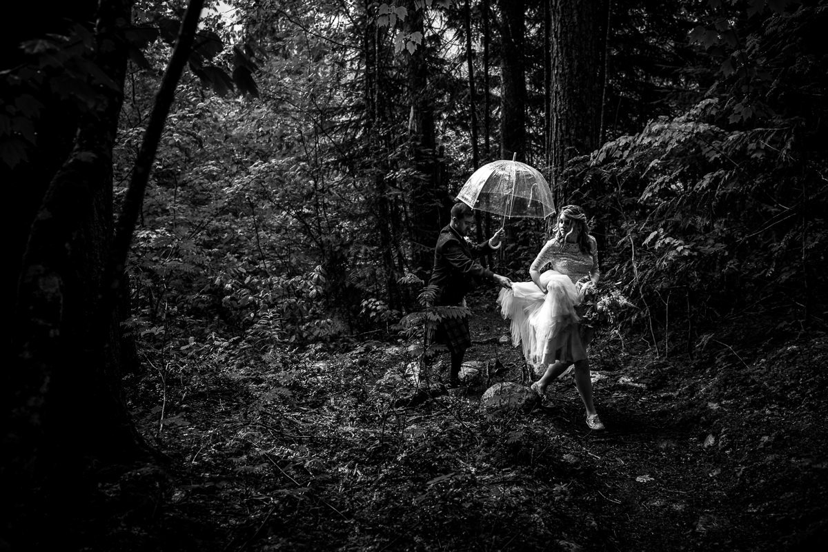 Bride and Groom walk in the rain during their revelstoke bc wedding