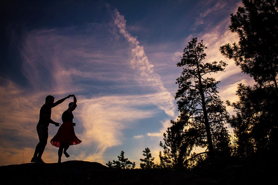 Couple silhouetted dancing at sunset near nelson bc