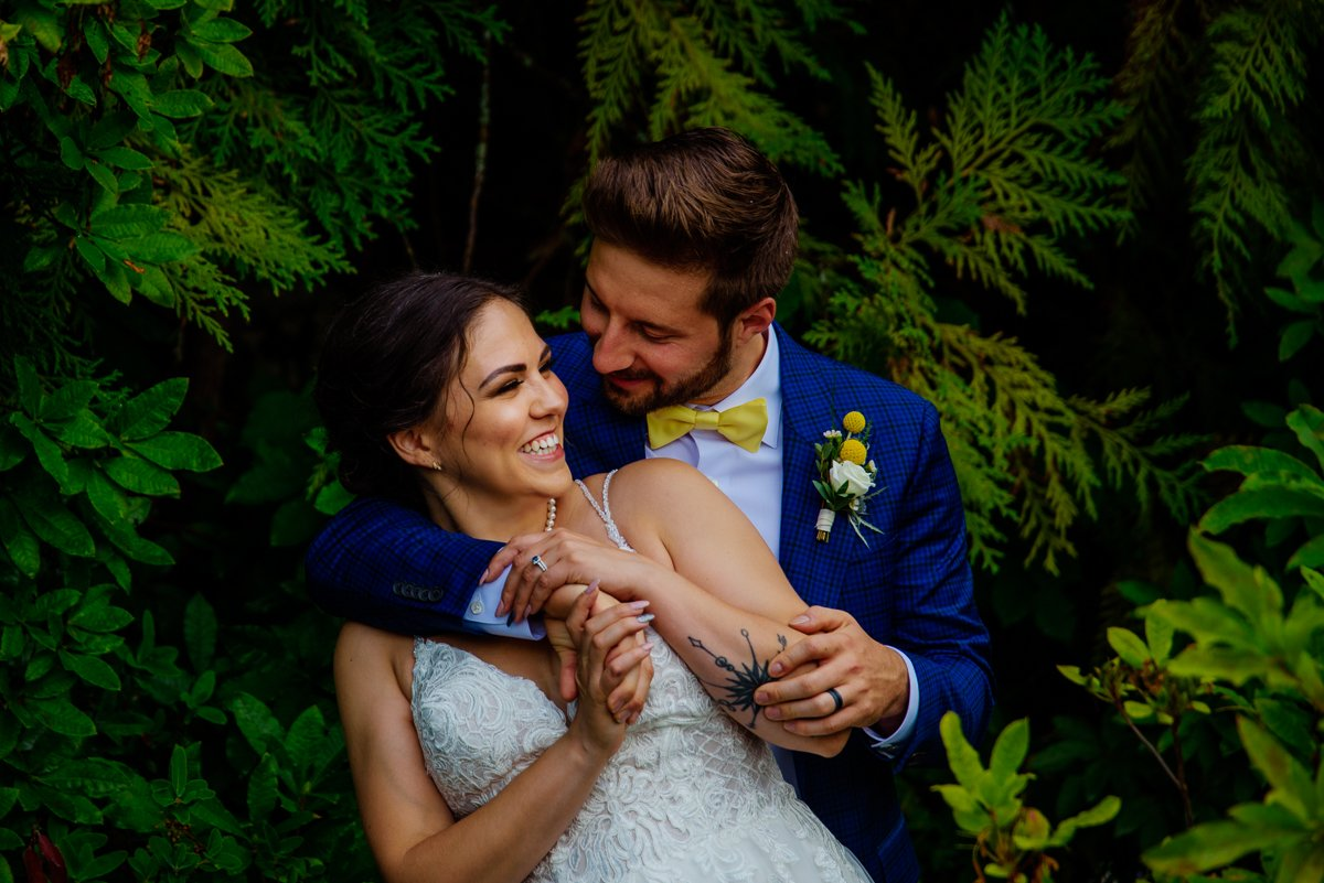Wedding couple portrait in the greenery at blaylock mansion
