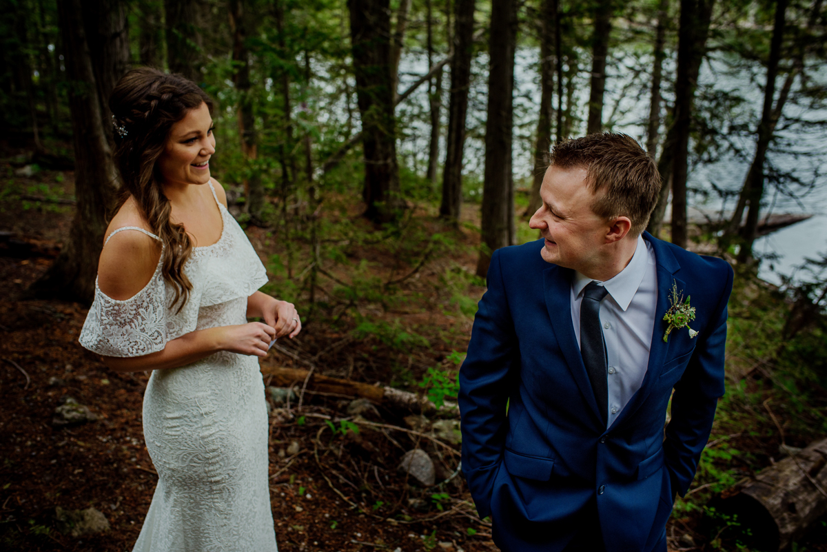 Groom looks at bride during their first look